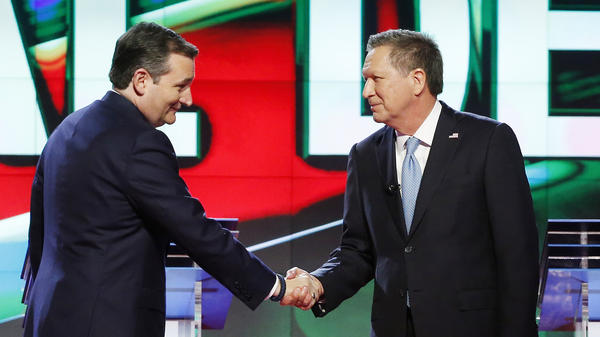 Republican presidential candidates Ted Cruz and John Kasich shake hands at the start of a CNN debate in Coral Gables, Fla., in March.