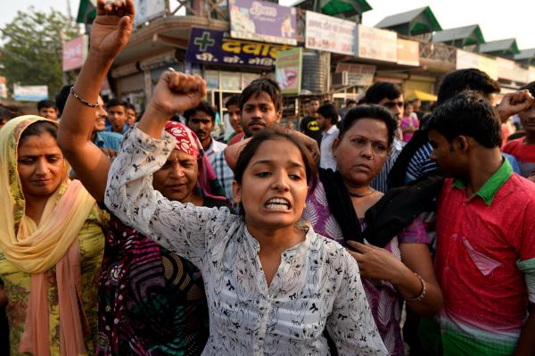Protesters rally near the home of a girl who was raped in New Delhi on Oct. 17. The Indian government is trying to improve its emergency response system, particularly in cases of assault.