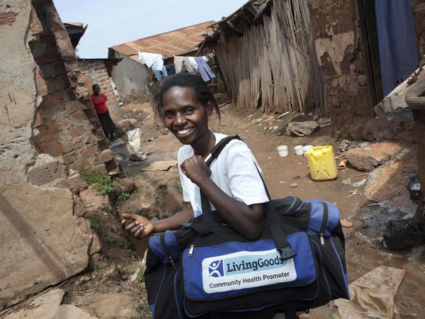 A Living Goods agent goes door-to-door in Bwaise, a neighborhood in Kampala, Uganda's capital.