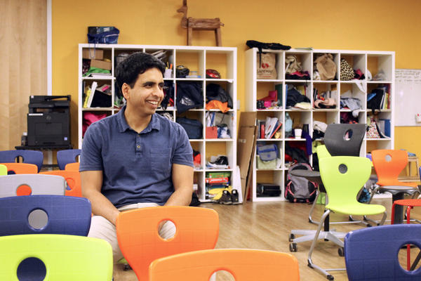 Sal Khan, founder of the Khan Academy, sits in the main room of his laboratory school in Silicon Valley.