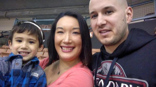 Nancy Glynn, her husband, Michael Gebo, and their son, Hunter, attend a minor league baseball game near their home in Manchester, N.H.