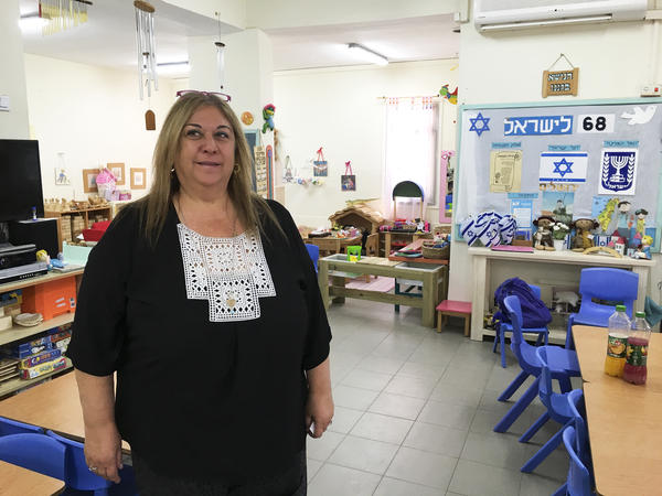Kindergarten teacher Nava Ron says she's always explained a little bit about Holocaust Remembrance Day to help her students understand what is happening around them. She tells children it was part of a war a long time ago and far away, and she focuses on themes of tolerance and heroism.