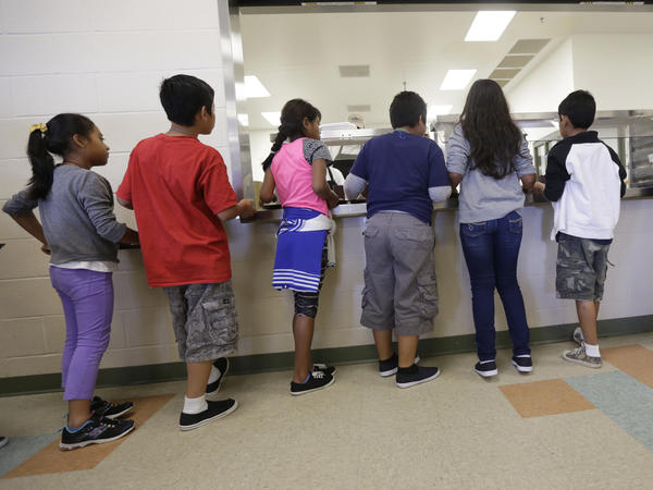 Detained immigrant children line up in the cafeteria at the Karnes County Residential Center, in Karnes City, Texas, a temporary home for immigrant women and children detained at the border.