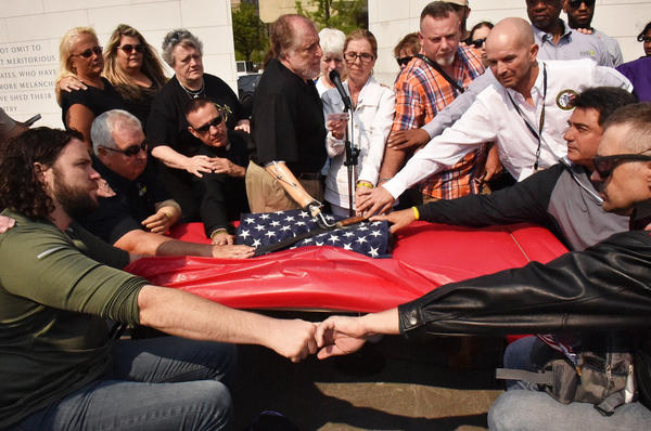 At a weekend gathering, Veterans conduct the Spartan Pledge, a promise made between veterans not to commit suicide. This one took place May 8 at the American Veterans Disabled for Life Memorial in Washington.