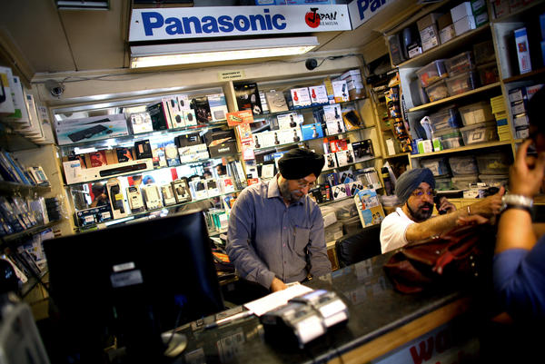Indrajit Singh (left) and his brother Baljeet Singh (right) own an electronics shop in New Delhi. They saw a spike in sales of air filters as public awareness of the city's filthy air increased around the time of President Obama's visit last year.