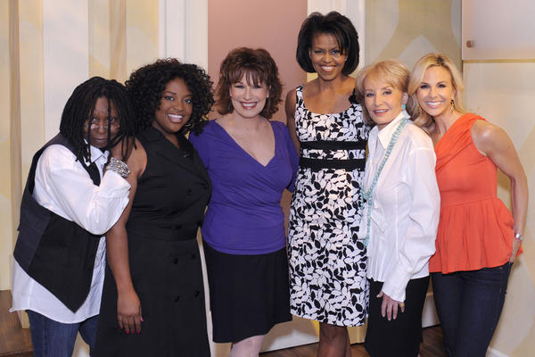 Michelle poses with the co-hosts of <em>The View on</em> June 18, 2008. Her dress from White House/Black Market sold out completely after her appearance on the show.