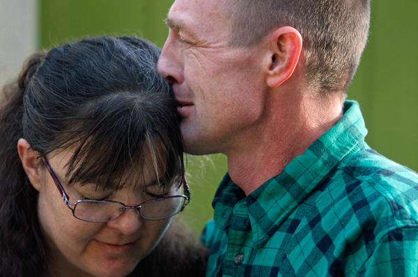 Lapinski kisses his wife, Michelle, at their home in Superior, Mont.