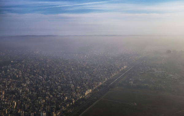 A blanket of smog extends over a densely populated neighborhood adjacent to the main airport in New Delhi in March. New Delhi's air pollution is among the world's worst.