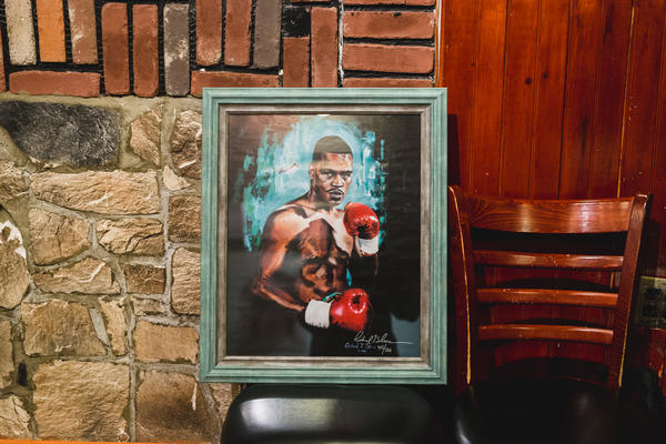A painting of Gerald McClellan, a former WBC and WBO middleweight champion who is currently suffering from brain damage. In an effort to cover hospital expenses Ring 10 is helping raise money through the auctioning of these pieces.