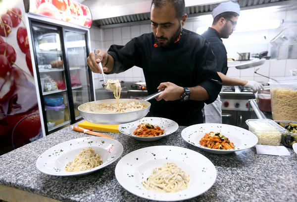 Libyan chefs whip up meals at Toucan, a newly opened Mediterranean restaurant in Tripoli.