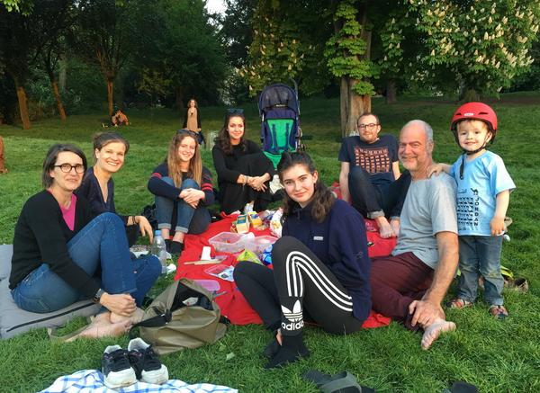 The Le Bourdon family and friends spend the evening in the Paris park of Buttes Chaumont. The city plans to leave many of its parks, including the largest ones, open all night this summer, a move supported by Parisians.