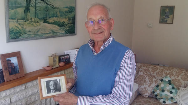 """John Fieldsend, 84, with a photo he keeps on his fireplace mantel of Nicholas Winton, the man who saved his life. Fieldsend, born Hans Heini Feige, was one of 669 mostly Jewish children whom Winton rescued from Czechoslovakia just prior to World War II. For his efforts, Winton is called """"Britain's Schindler."""" He died last year at 106."""