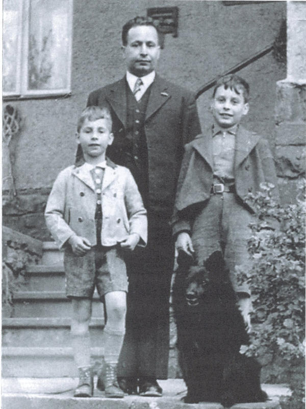 John Fieldsend (left), age 7, with his father, Curt Feige, and older brother, Arthur, age 10, in the final photograph taken of them together in 1939, on the day the boys boarded a Kindertransport train bound for England. Curt Feige and his wife, Trude, were murdered by the Nazis at Auschwitz in 1943.