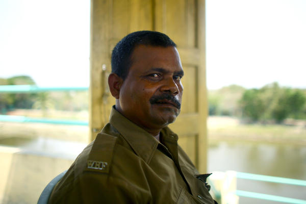 "Debnath Mondal was attacked by a tiger in 2010. ""I saw the tiger coming in. Everyone shouted, 'Tiger!' But before I could do anything, it pounced on me. It landed on my thighs and chest and bit my face and head,"" he says. Though seriously injured, he continues to work as a guard in the national park in the Sundarbans."