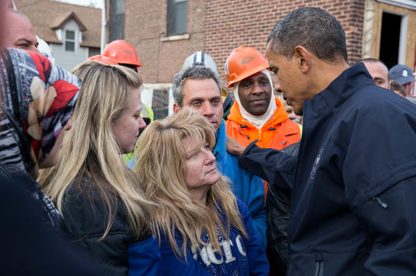 President Obama talks with Diane and Nick Camerada (center) during a walking tour of Superstorm Sandy storm damage on Staten Island, N.Y., on Nov. 15, 2012.