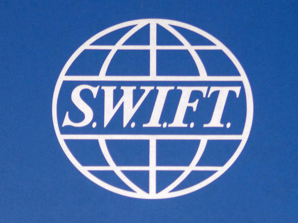 A sign for the Society for Worldwide Interbank Financial Telecommunication (SWIFT) outside the group's headquarters in Brussels.