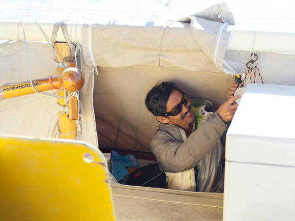 """Behind the canvas on both sides of the boat are the small, 6-foot """"holes,"""" or cubbies, which are the sleeping quarters for crew members. They have a sleeping bag, clothes and a few personal effects for the journey. Underneath the sleeping mat is storage space for food, water and other supplies."""