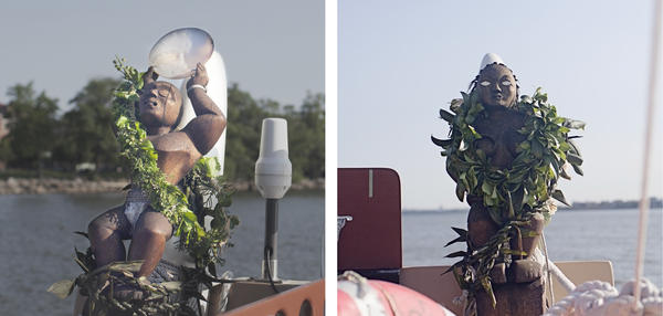 Ki'i, statues that help guide the vessel, are on either side of the boat. Only the female (right) has eyes because she sees the way while the male counterpart stands guard.