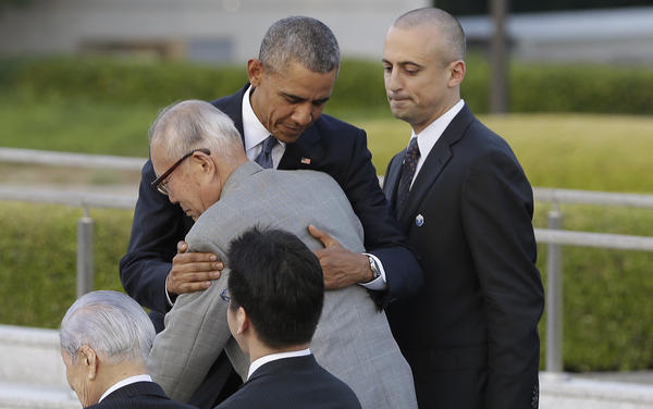 President Obama hugs Shigeaki Mori, an atomic bomb survivor and a creator of the memorial for American WWII POWs killed in Hiroshima, during a ceremony at Hiroshima Peace Memorial Park in Hiroshima on Friday. Obama became the first sitting U.S. president to visit the site of the world's first atomic bomb attack.