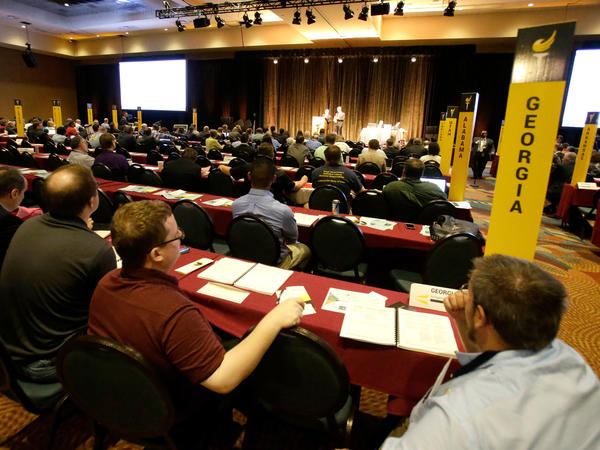 Delegates listen to speeches in the main hall at the National Libertarian Party Convention, Friday, May 27, 2016, in Orlando, Fla.