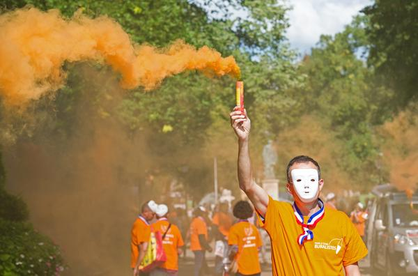 A demonstrator holds a smoke flare during a protest last September against the French government's plan to change cigarette packaging to place greater emphasis on the health risks. The new packaging will be phased in over the next six months. The smoking rate in France remains high, particularly among young people.