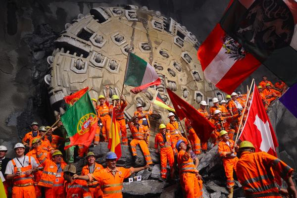 Miners celebrate beneath the Swiss Alps in 2010, after a giant drilling machine bored through to create the world's longest tunnel. After several more years of work, the train line through that tunnel is now open.
