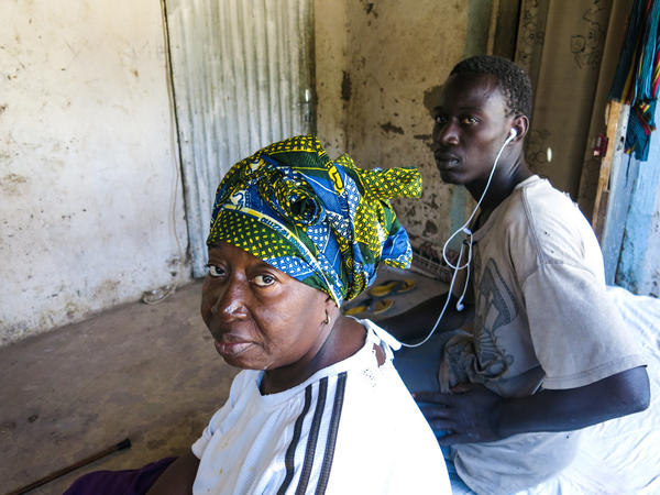 Kadiatou Cisse and her youngest son, Souleymane Sebor, who tried and failed to get to Italy.