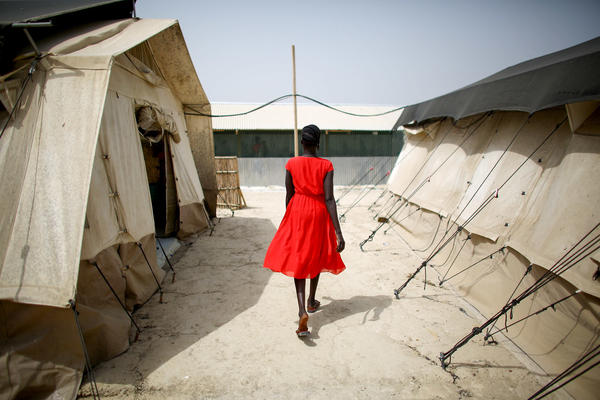 Earlier this year, a woman walks between two of the tents that house the hospital wards at the U.N. Protection of Civilians site near Bentiu, South Sudan, home to more than 120,000 people. Most of the camp's residents are women and children.