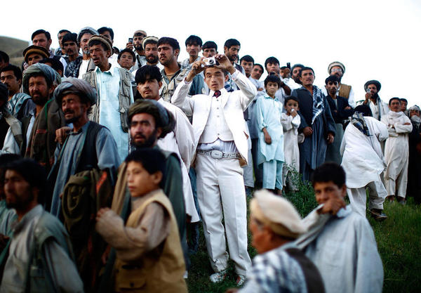 """Afghan president Hamid Karzai held a rally in a remote village, where he struck a deal with an influential religious leader. Thousands gathered for the campaign event. <em>From the story """"<a href=""""http://www.npr.org/templates/story/story.php?storyId=111605691"""" target=""""_blank"""">Afghan President Karzai Rallies Support</a>,"""" 2009.</em>"""