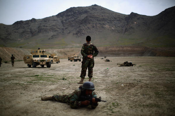 An Afghan commando instructor looks out over his troops during a training exercise last year.