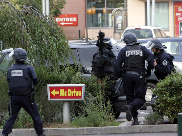 Police officers surround a McDonald's restaurant after a different robbery attempt at a McDonald's north of Paris in 2006. In this latest attempt, the robbery was foiled by French paramilitary forces who just happened to be eating some burgers when the robbers burst in.