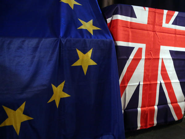 "European Union and U.K. Union Jack flags hang at a meeting for U.K. citizens living in Germany to discuss the implications of the proposed ""Brexit"" from the EU."