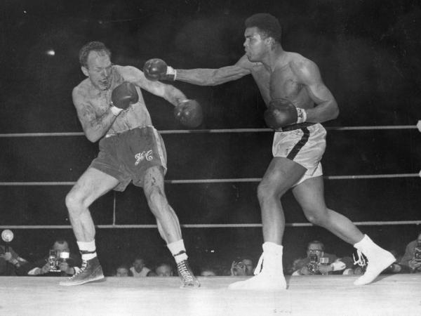 American boxer and world heavyweight champion Muhammad Ali throws a long right to British challenger Henry Cooper's injured left eye in the sixth round of their world heavyweight championship fight.