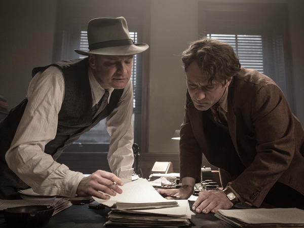 Perkins and Wolfe lean over the novelist's unwieldy manuscript.