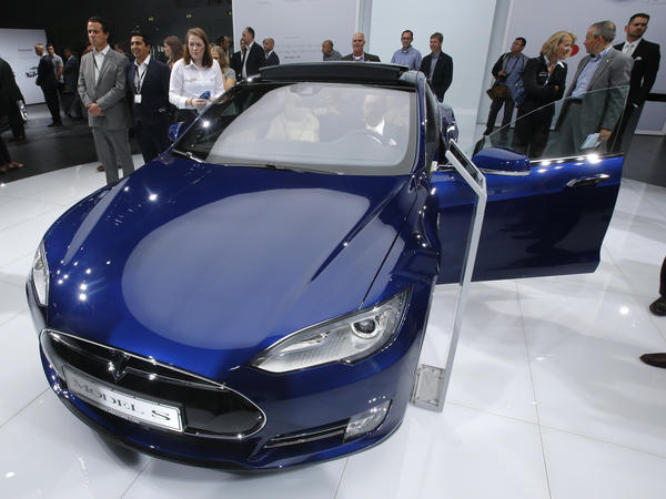 A Tesla Model S on display at the Frankfurt Auto Show in 2015. Safety regulators are looking into a report of a possible safety issue with the suspension on the Model S.  Tesla denies that there is any safety problem.