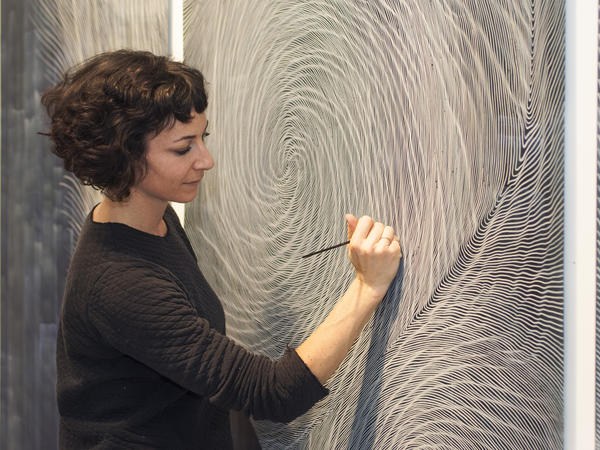 Linn Meyers' drawings have swirling lines that curve and spiral together, almost like a fingerprint.