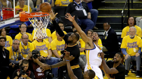 LeBron James of the Cleveland Cavaliers goes up for a shot Monday night in front of James Michael McAdoo of the Golden State Warriors in the first half in Game 5 of the 2016 NBA Finals in Oakland, Calif.