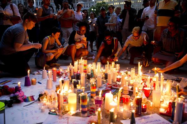 People gather Monday in Philadelphia for a vigil in memory of the victims of the Orlando, Fla., mass shooting.