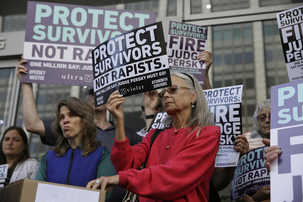 Activists from UltraViolet, a national women's advocacy organization, hold a rally Friday in San Francisco before delivering more than 1 million signatures to the California Commission on Judicial Performance calling for the removal of Judge Aaron Persky from the bench.