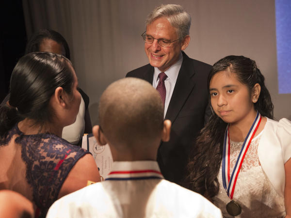 Garland with Jenifer Morales-Garcia (right), 11, whom he tutored this year.