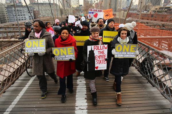 Participants with One Million Moms for Gun Control, a gun control group formed in the wake of the mass shooting at a Newtown, Conn., elementary school, hold a rally and march across the Brooklyn Bridge in New York City in January 2013.
