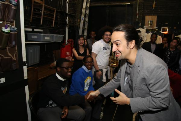 Lin-Manuel Miranda greets student performers backstage at the Richard Rodgers Theatre.