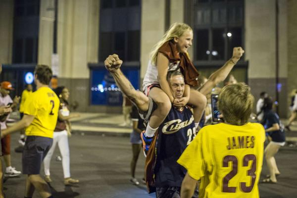 Cleveland Cavaliers fans celebrate in the street after the Cavs defeated the Golden State Warriors to win the NBA Championship.