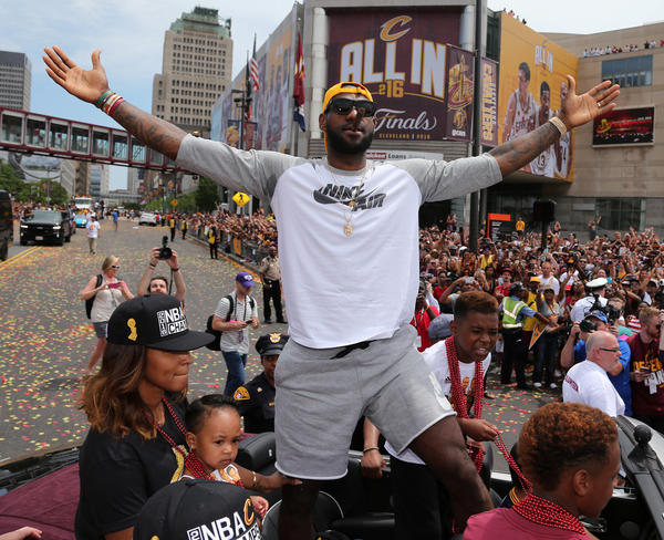 Cleveland Cavaliers forward LeBron James cheers along with the crowd during a parade Wednesday in downtown Cleveland to celebrate the team's 2016 NBA championship.