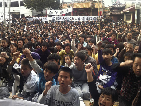Wukan villagers, shown protesting in December 2011, chased Communist Party officials out of their hamlet and elected a new leader. Now they're protesting again.