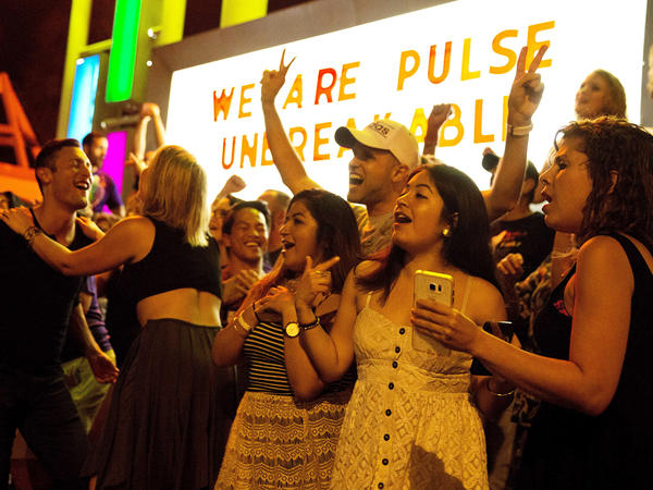 "Club goers dance outside Parliament House, an LGBT nightclub, about a week after the Pulse nightclub mass shooting in Orlando. Pulse's owner has announced a ""Latin Night"" street party for Thursday, June 23."