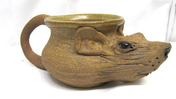 """A rat cup — used by """"Whitey"""" Bulger to store pens — is among the more popular items being auctioned off by the U.S. Marshals."""