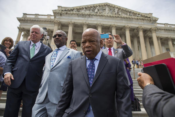 Rep. John Lewis, D-Ga., leads lawmakers down the steps of the Capitol to greet a crowd assembled after House Democrats ended their 26-hour-long sit-in protest on Thursday.