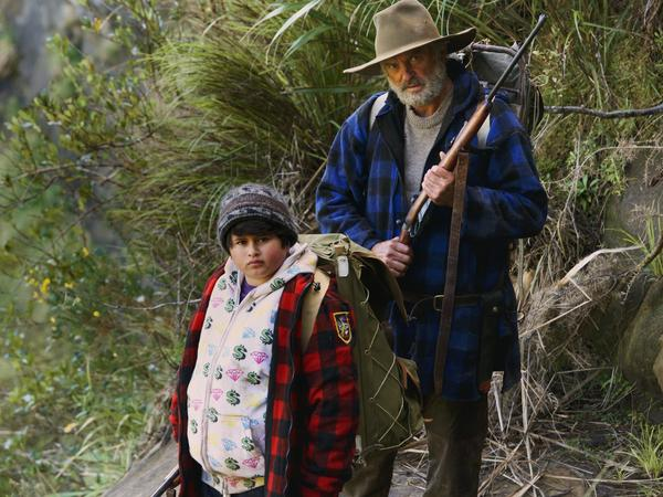 Ricky the city kid (Julian Dennison) and Hector the mountain man (Sam Neill) journey through the wilderness in <em>Hunt for the Wilderpeople</em>.