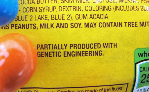 """A new disclosure statement on a package of peanut M&Ms candy notes they are """"partially produced with genetic engineering."""""""
